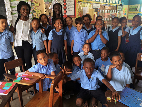 Fatma Diouf and Ada Ozumba with classroom in Belize
