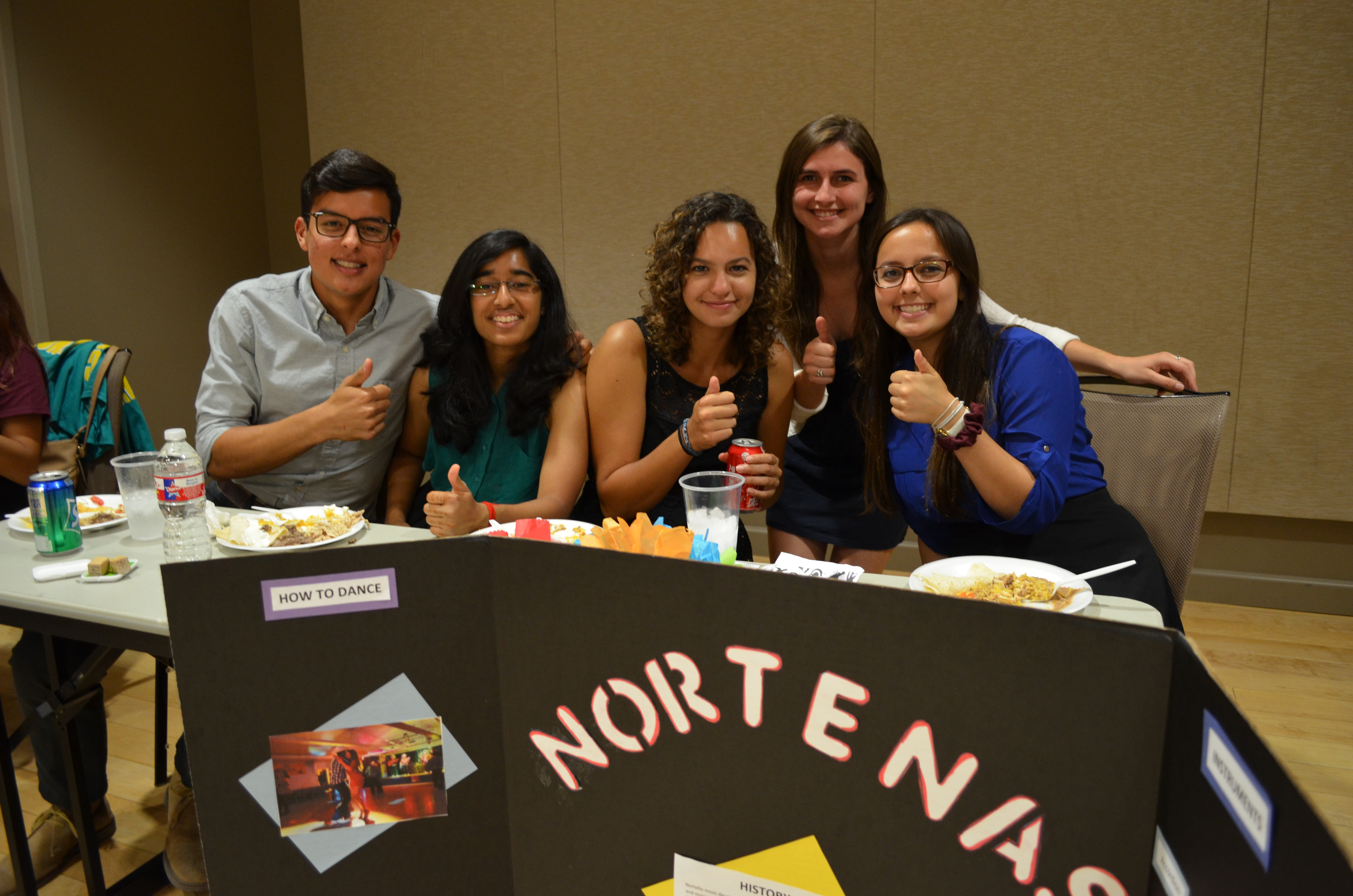 Students eating at Latin Dance Night event